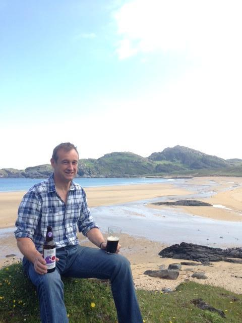 Chris Nisbet enjoying beer on Kiloran Beach