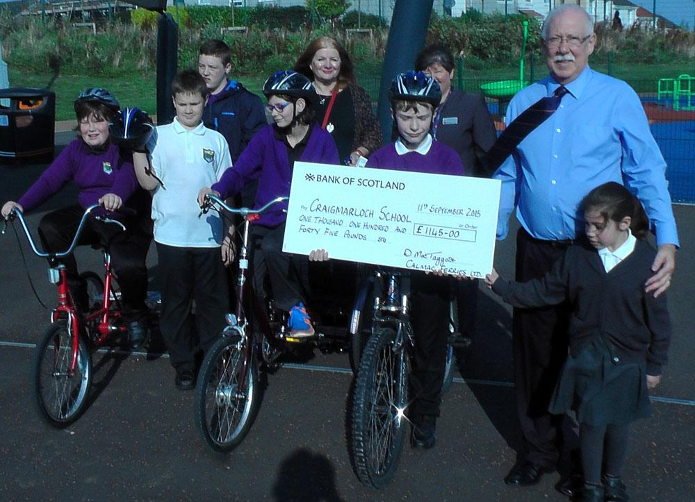 CalMac staff with charitable donation to Craigmarloch School