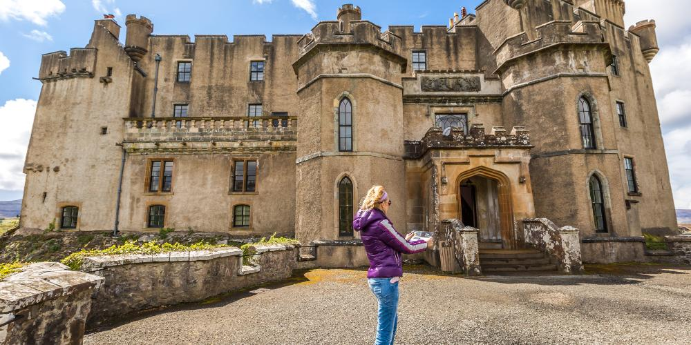 Woman outside Dunvegan Castle