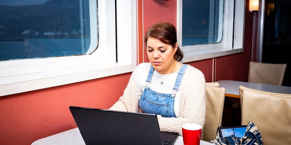 girl with laptop on board ferry