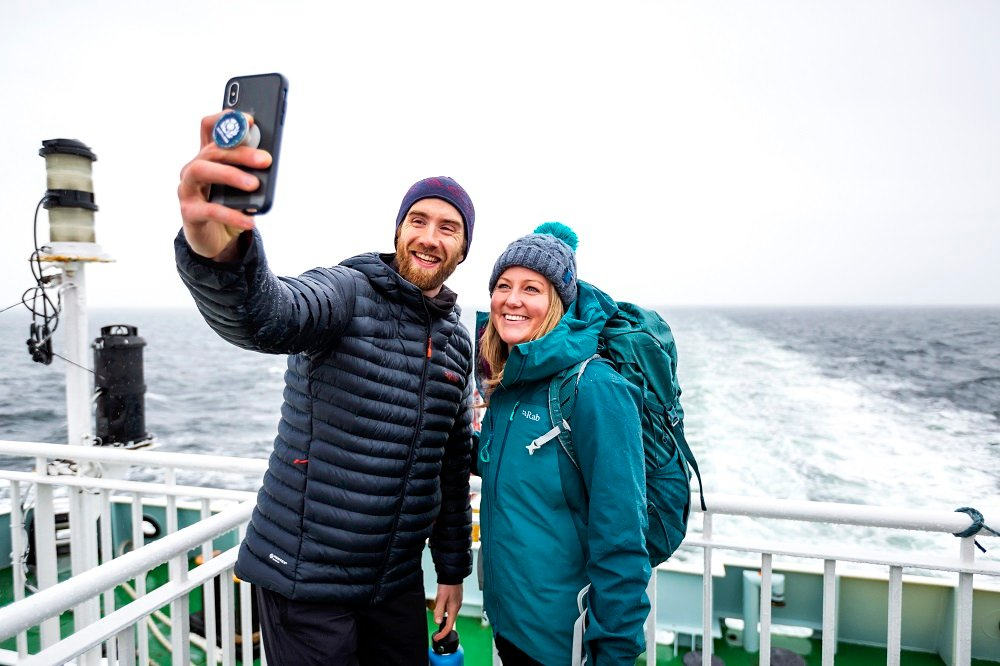 couple taking a selfie on ferry